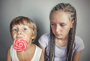 35811677 - sister jealous brother who eats candy